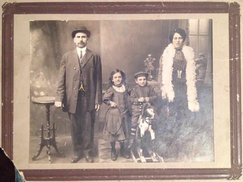 Polish Jewish mother, father, young son and daughter posing in their best clothes for formal family photo circa 1915.